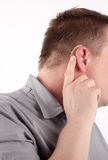 Wearing a hearing aid Stock Images