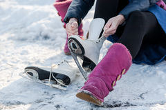 Wearing ice skates at a wintertime, on frozen pond Stock Photography