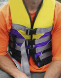 Wearing a life jacket. Young man wearing a life jacket Royalty Free Stock Photography