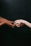 Wearing marriage ring, proposal. Black, white hand Royalty Free Stock Photos