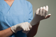 Wearing Medical Gloves. A surgeon wearing medical gloves royalty free stock photo
