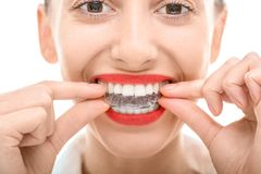 Wearing orthodontic silicone trainer Royalty Free Stock Image