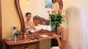 Wearing Perfume. Bride applying her perfume before the ceremony stock footage