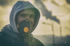 Wearing a real anti-pollution, anti-smog and viruses face mask royalty free stock images