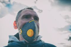 Wearing a real anti-pollution, anti-smog and viruses face mask stock image