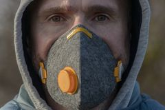 Wearing a real anti-pollution, anti-smog and viruses face mask stock photos