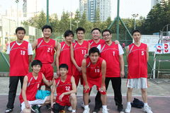 Wearing red ball clothing OF THE staff basketball team in SHENZHEN Stock Images