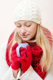 Wearing red knitted scarf and gloves with cup of drink Stock Photo