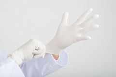 Wearing rubber gloves Royalty Free Stock Photography