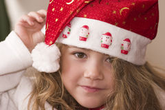 Wearing Santa hat Royalty Free Stock Images