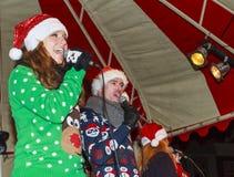 Wearing Santa hats Stock Images