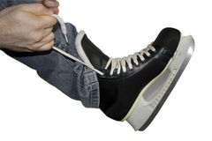 Wearing skate. A man is wearing an ice skate Stock Images