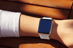 Wearing Smart Watch. Women Wearing Smart Watch White Strap Royalty Free Stock Photo