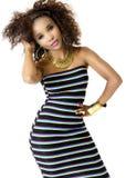 Wearing Striped Dress modelo femenino africano, joyería del oro Imagen de archivo