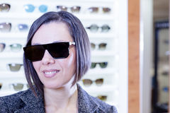Wearing sunglasses at optical store Royalty Free Stock Images