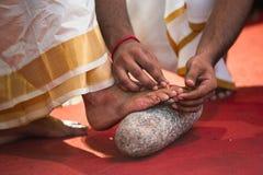 Wearing toe ring at a Tamil Hindu wedding Royalty Free Stock Photography