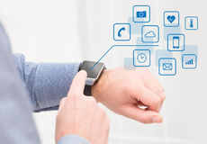 Wearing touchscreen smartwatch with app icons. Abstract smart watch concept Royalty Free Stock Photos