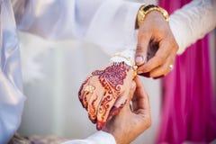 Wearing the wedding bracelet Stock Photos