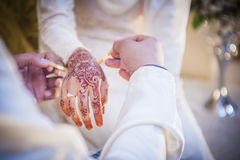 Wearing the wedding bracelet Stock Images