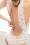 Wearing wedding dress. The bride is wearing a wedding dress Stock Photos