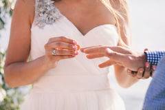 Wearing wedding ring ceremony Stock Image