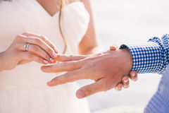 Wearing wedding ring ceremony Stock Photography