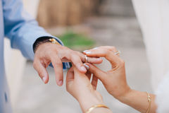 Wearing wedding ring ceremony Stock Images