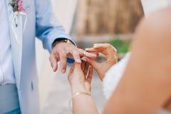Wearing wedding ring ceremony Stock Image
