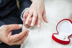 Wearing wedding ring on hand Stock Image