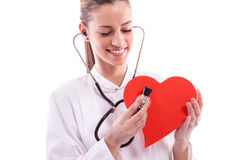 wearing a white coat with a Heart Stock Photography
