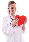 wearing a white coat with a Heart Royalty Free Stock Image