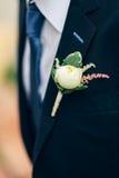 Wearing white rose boutonnieres Royalty Free Stock Image