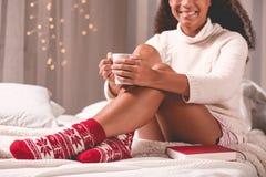 Wearing woolen sweater and socks Stock Photo
