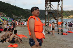 Wearing yellow life vests of tourists in SHENZHEN Stock Images