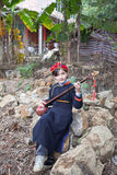 Wearing Zhuang clothing girl playing the guqin. April 29, Napo County, Baise City in China.Wearing Zhuang clothing girl playing the guqin Stock Photos