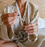 She wears a robe 2 stock photo