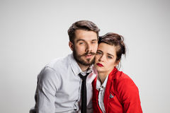 The weary business man and woman. The weary business men and women on a gray background stock images