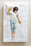 Weary child resting after exercising Royalty Free Stock Photo