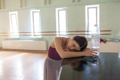 Weary classic ballet dancer in rehearsal room. The weary classic ballet dancer in a  rehearsal room background Stock Image