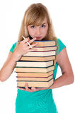 Weary girl holds lot of books Royalty Free Stock Images