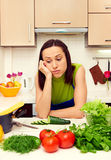 Weary housewife. Standing in kitchen stock images