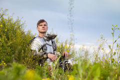 Weary knight, after the battle. / think about  past Stock Photography