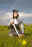 Weary knight, after the battle /  rain and rainbow. Weary knight, after the battle / rain and real rainbow Stock Images