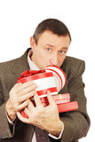 Weary man with a lot of presents. Isolated over white background Stock Photos
