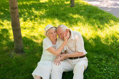 The weary old couple in the summer on a walk Royalty Free Stock Photo
