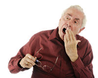 A Weary Old Man. A weary senior man with a big yawn royalty free stock images