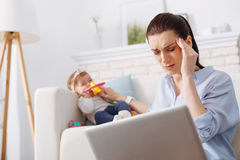 Weary overwhelmed mother having a severe headache Royalty Free Stock Photo