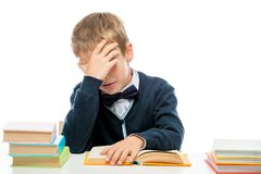 Weary sleepy schoolboy reading lessons. Portrait isolated royalty free stock photography