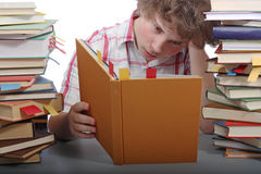 Weary student. Tries to read a book royalty free stock photography