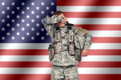 Weary us soldier. On american flag background stock images